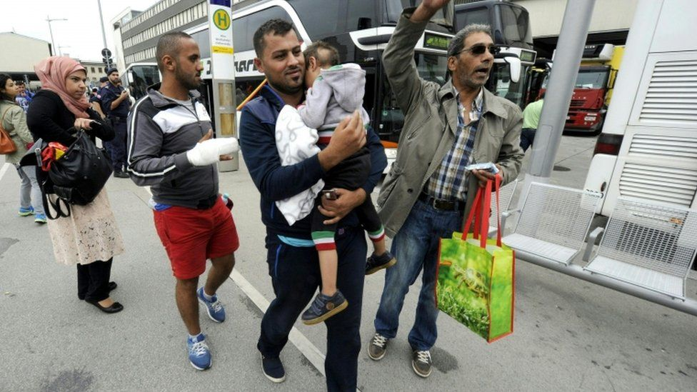 Refugees after getting off a bus arriving from the Hungarian border to Vienna, 5 September