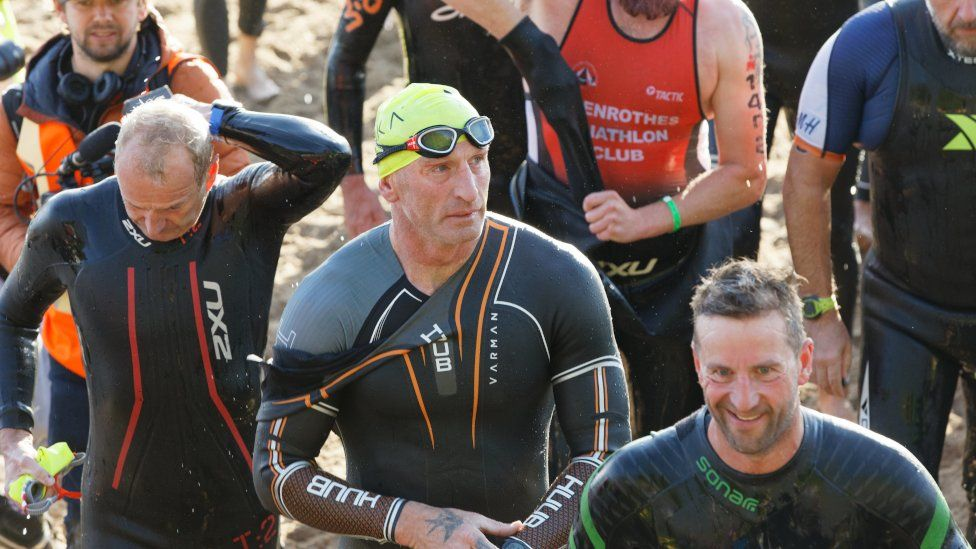 Gareth Thomas emerges from the sea swim in the Ironman triathlon