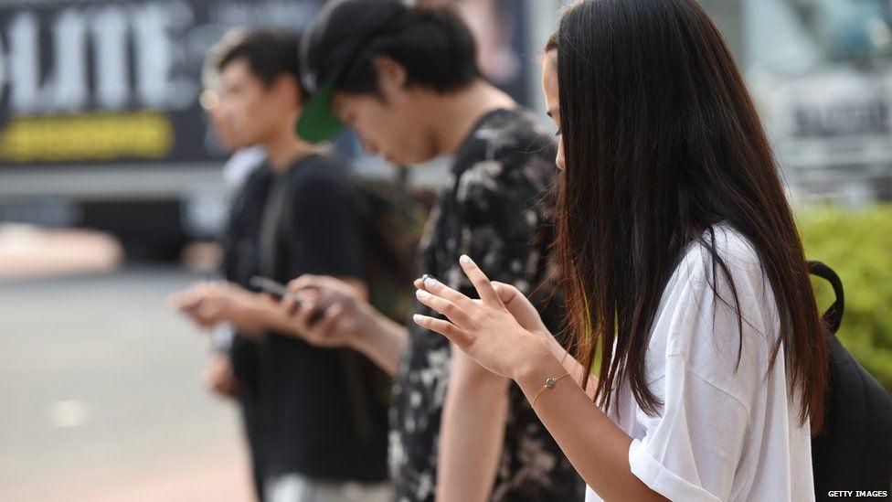 People use their smartphones on 16 July, 2014 in Tokyo, Japan