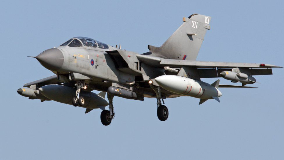 Armed British RAF Tornado combat aircraft, fighter plane in flight, 2011