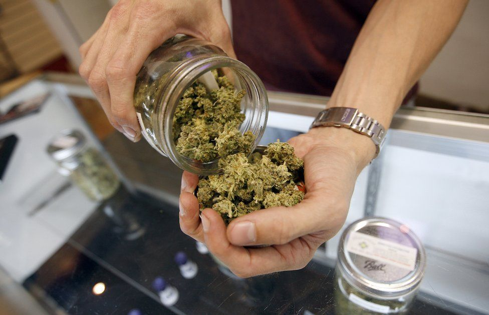A vendor weighs buds for card-carrying medical marijuana patients in Los Angeles, California