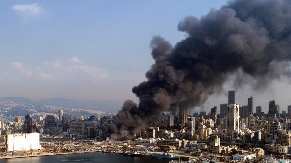 A picture taken with a drone shows thick smoke billowing over Beirut on 10 September 2020