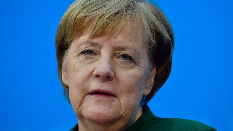 German Chancellor Angela Merkel gives a press conference on 27 November