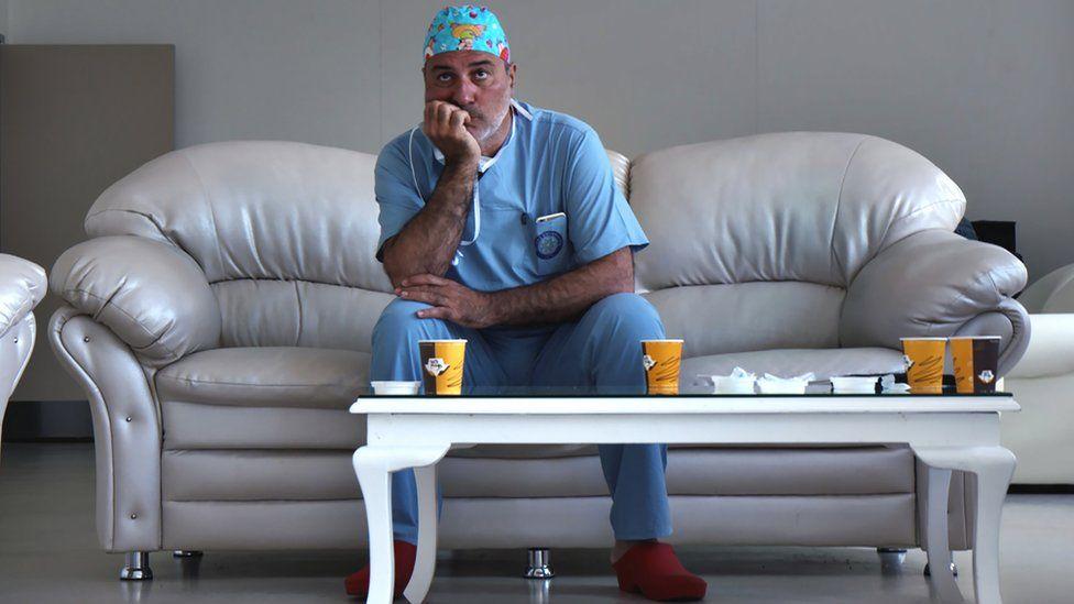 Paolo Macchiarini on a sofa