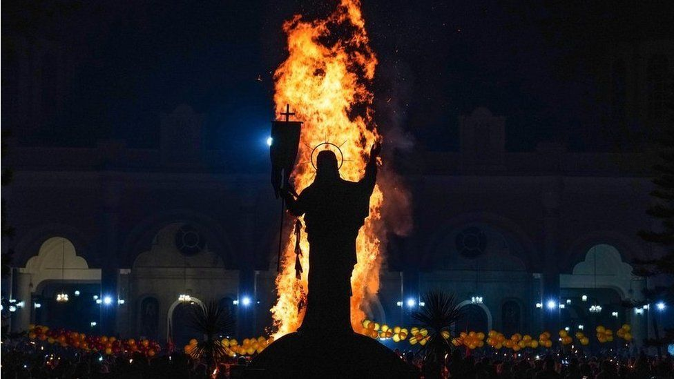 A blaze in front of a statue of Jesus Christ during the annual Meskel celebration at Bole Medhane Alem Church in Addis Ababa, Ethiopia - 26 September 2021