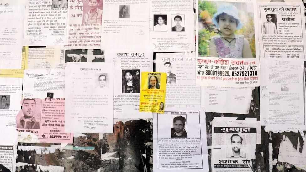 Missing posters filling a wall in Rishikesh - January 2017