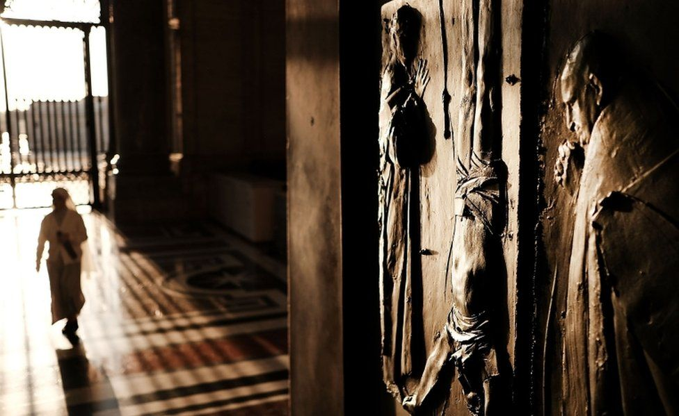 A door to St. Peter's Basilica in the Vatican stands open in the dawn light