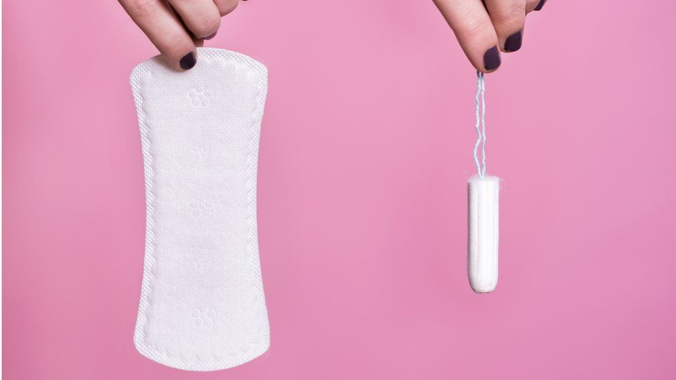 Women's hands holding sanitary products
