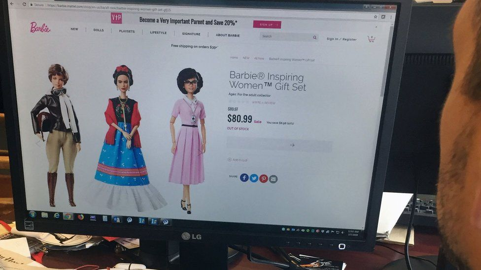 """A journalist looks at the new series of Barbie dolls, """"Inspiring Women"""", featuring (L-R) Amelia Earhart, Frida Kahlo and Katherine Johnson, on 7 March 2018 in New York"""