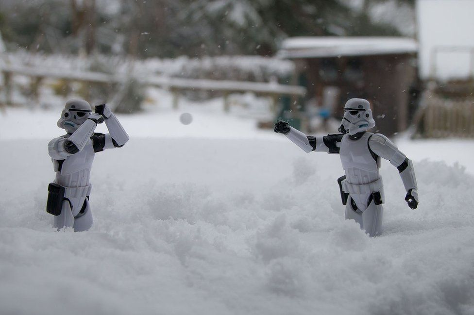 Stormtrooper figures in a snowball fight