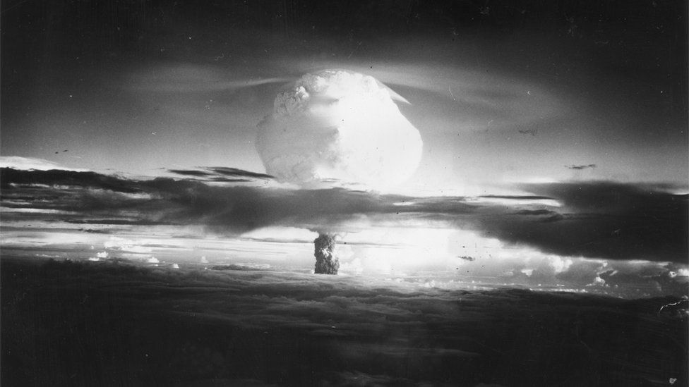 A mushroom cloud of fire and smoke rises 40,000 feet in two minutes after the Hydrogen Bomb explosion at Eniwetok Atoll in the Pacific, ~1952