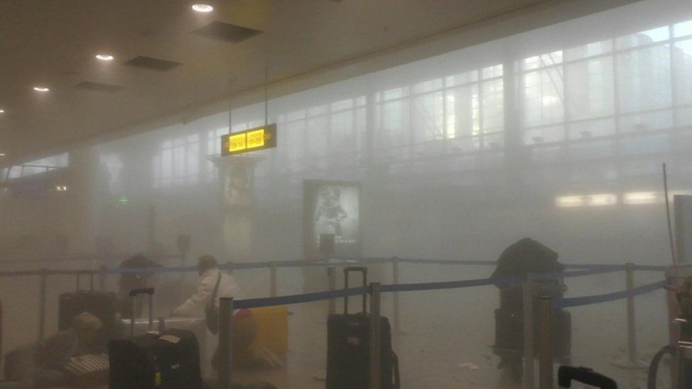 Smoke fills Brussels Airport after suicide attacks