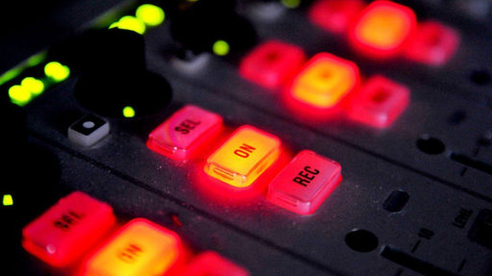 Faders in radio studio