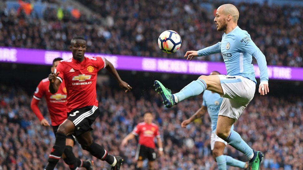 David Silva of Manchester City controls the ball during the Premier League match between Manchester City and Manchester United at Etihad Stadium