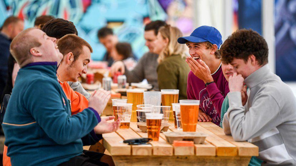 Members of the public in beer garden at SWG3 in Glasgow