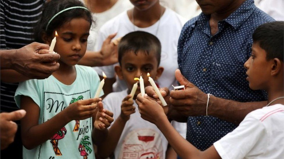 People light candles at the funeral of Dhami Brindya, 13, victim of a string of suicide bomb attacks on churches and luxury hotels on Easter Sunday, in Negombo, Sri Lanka April 25, 2019.