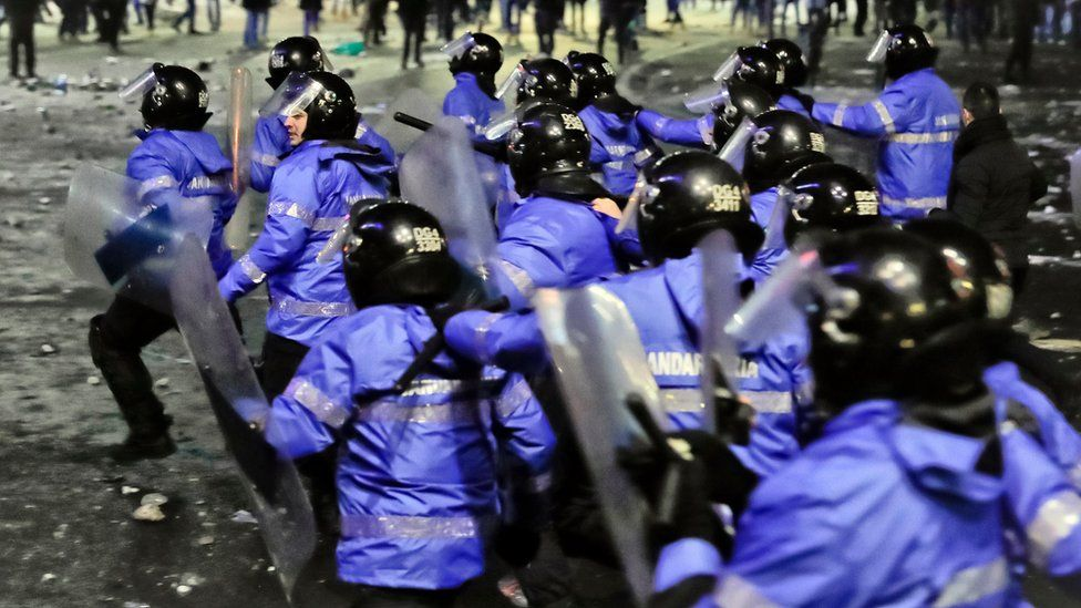 Romanian riot police charge after minor clashes erupted during a protest in Bucharest, Romania