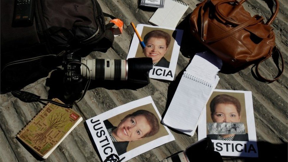 "Cameras and notebooks of journalists are seen during a protest against the murder of the Mexican journalist Miroslava Breach. Pictures of Miroslava read ""Justice"" (25/03/2017)"