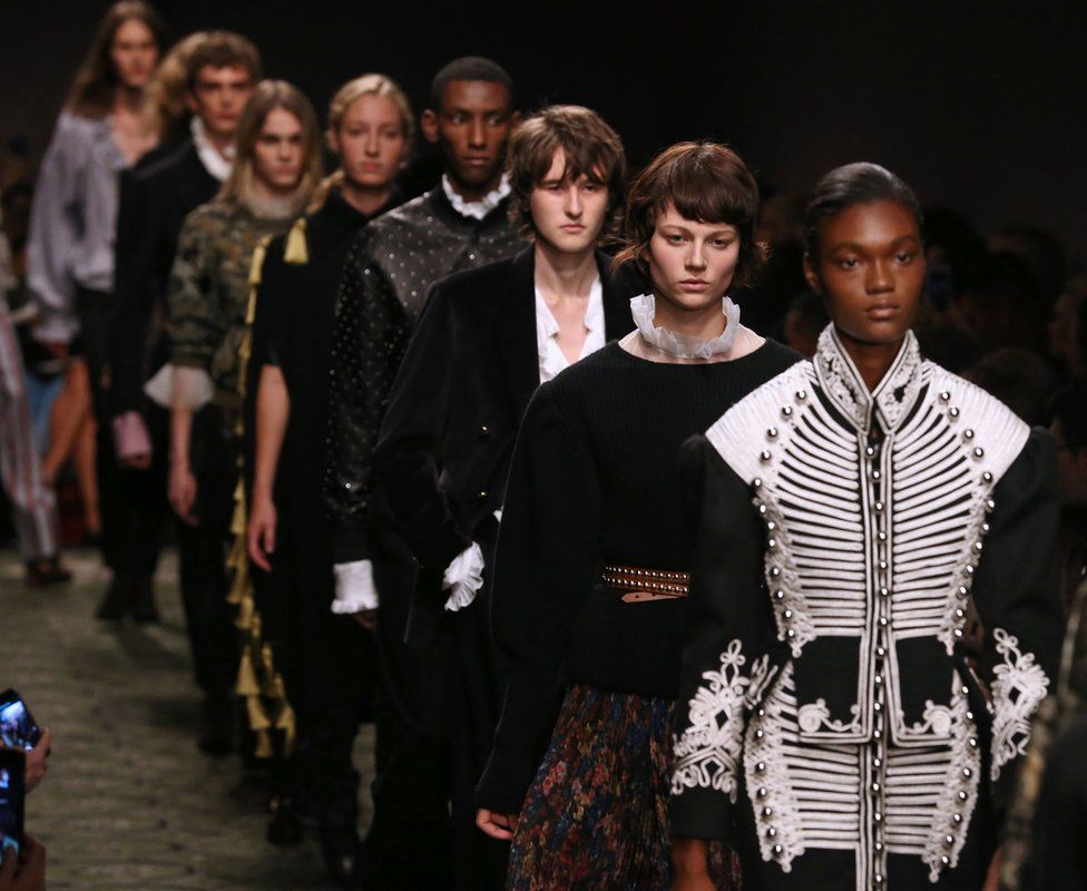 Burberry S/S 17 catwalk with men and women walking together