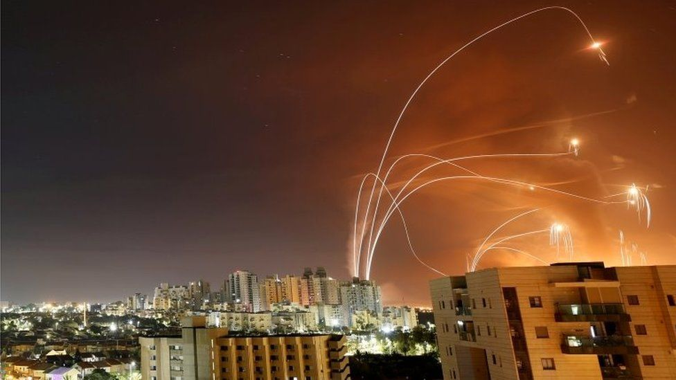 Streaks of light are seen as Israel's Iron Dome anti-missile system intercept rockets launched from the Gaza Strip, as seen from Ashkelon, Israel (12 May 2021)