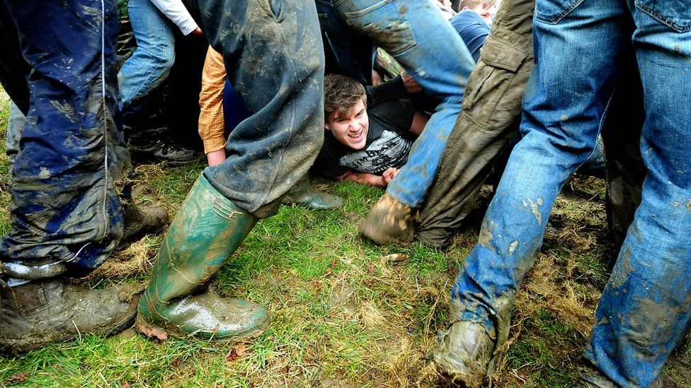 Thick of the action in the bottle kicking match