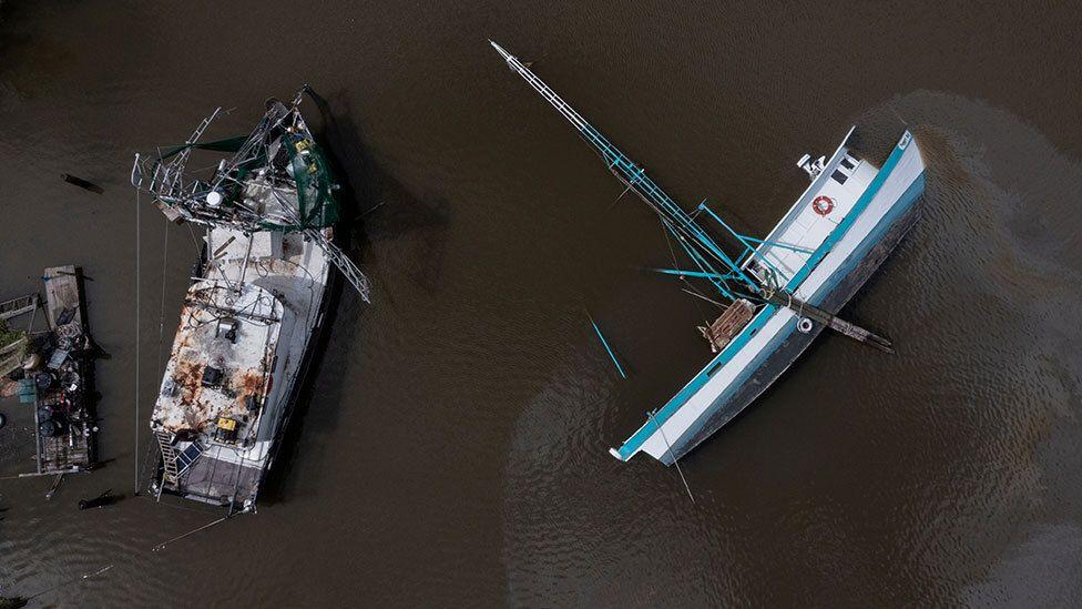 Capsized boat on the Bayou Lafourche in Galliano