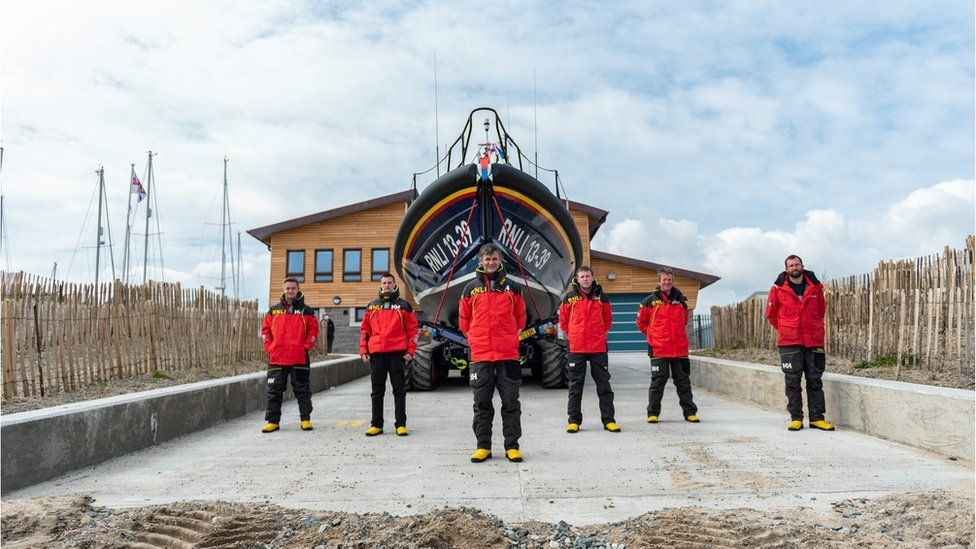 Crew of Pwllheli lifeboat outside their new home