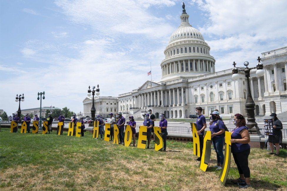Protesters outside the capitol building in Washington call for a second stimulus bill