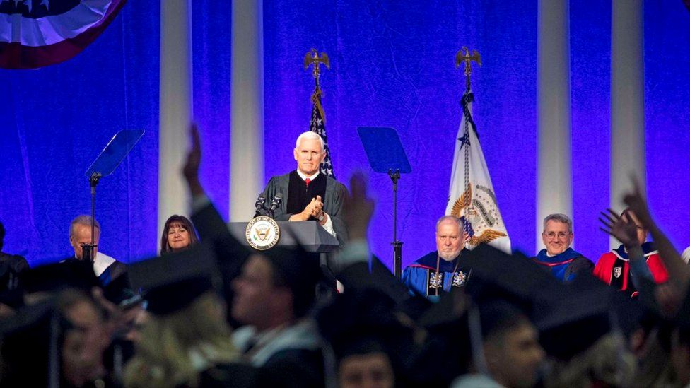 Mike Pence stands at the podium at Hillsdale College