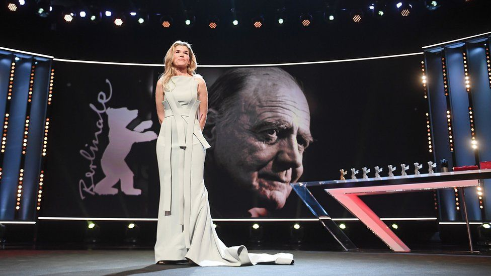 Anke Engelke is seen on stage (in the background actor Bruno Ganz)