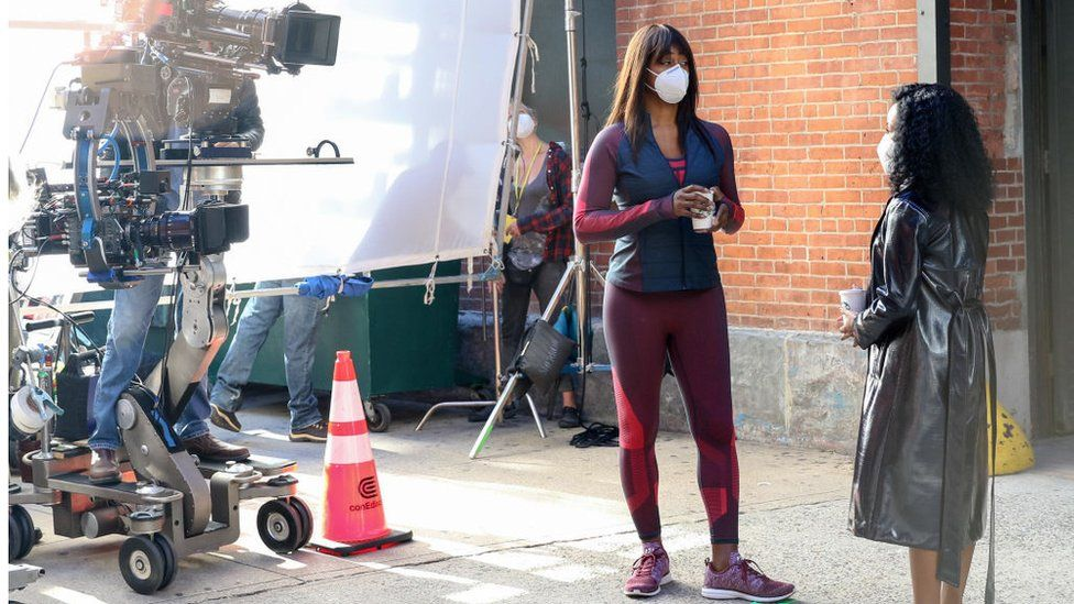 Laverne Cox on set as Anna's personal trainer, Kacy Duke, in the Netflix production Inventing Anna