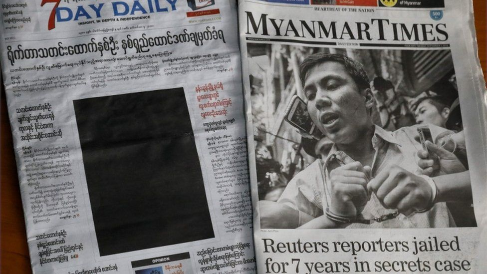 A black front page of 7Day daily and the Myanmar Times newspaper, showing the fall of press freedom in Myanmar