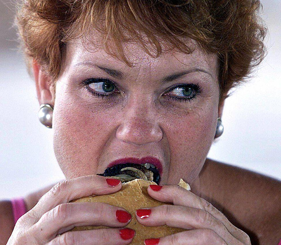 Pauline Hanson eats a burger