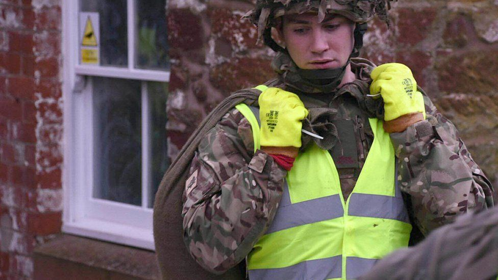 Members of the Army setting up flood defences in Appleby, north-west England, on 25 December 2015
