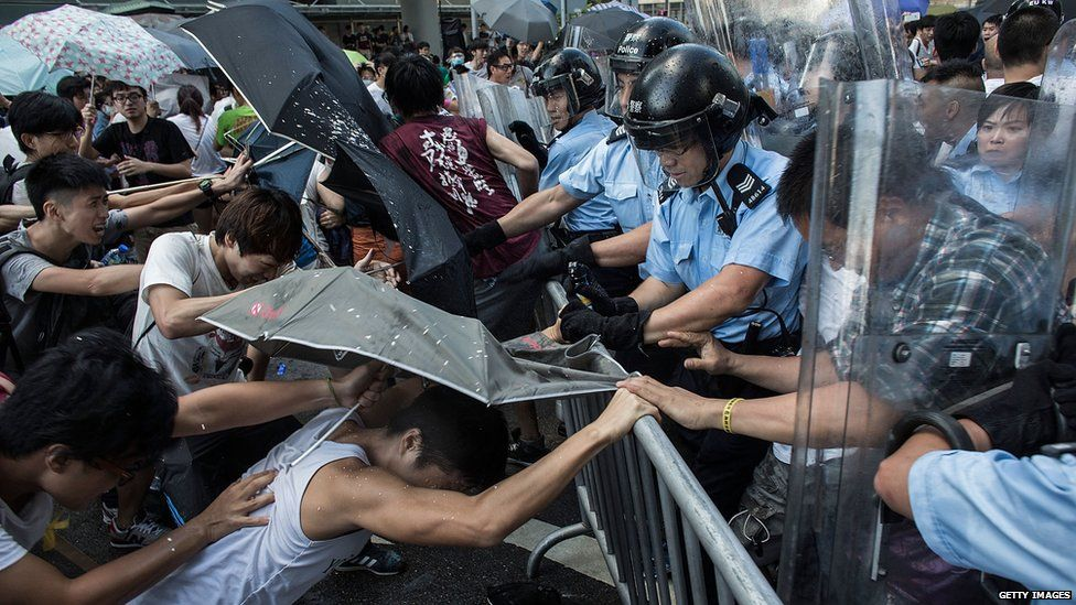 Protesters clash with riot police outside Hong Kong government complex on27 September 2014 in Hong Kong.