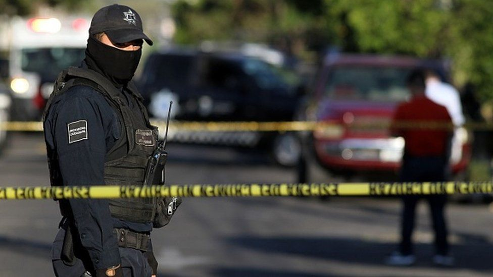 A police officer stands guard in Guadalajara, Mexico