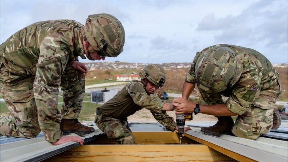 Marines mending roof