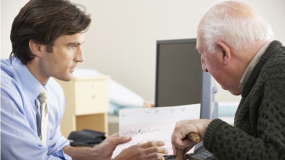 Doctor and male older patient