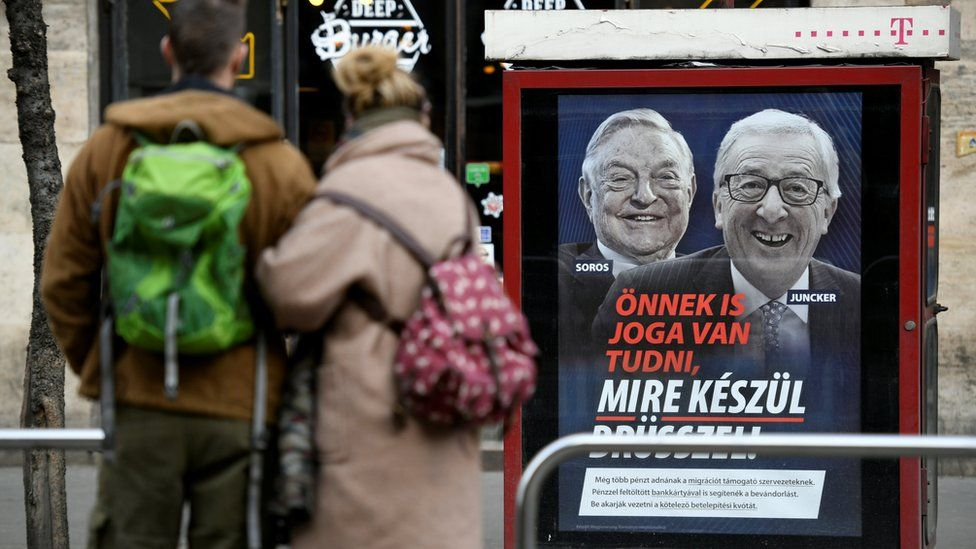 """Government poster is seen in Budapest, Hungary, February 21, 2019. The poster reads, """"You also have the right to know what Brussels is up to"""", accusing European Commission President Jean-Claude Juncker of pushing migration plans encouraged by U.S.-Hungarian businessman George Soros"""