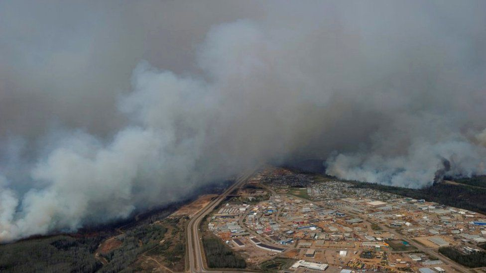 A Canadian Joint Operations Command aerial photo shows wildfires near neighborhoods in Fort McMurray, Alberta