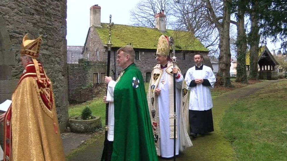 The Most Rev John Davies enters Brecon Cathedral ahead of his enthronement