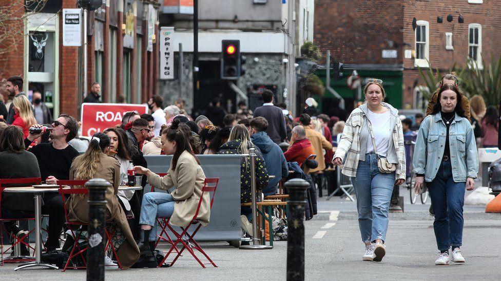 People enjoying restaurants in Stevenson Square in Manchester