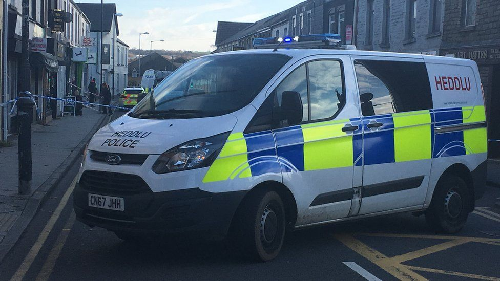 A police van on High Street