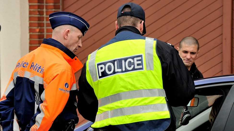 A Belgian (left) and a French police officers take part in a road traffic control in March 2013
