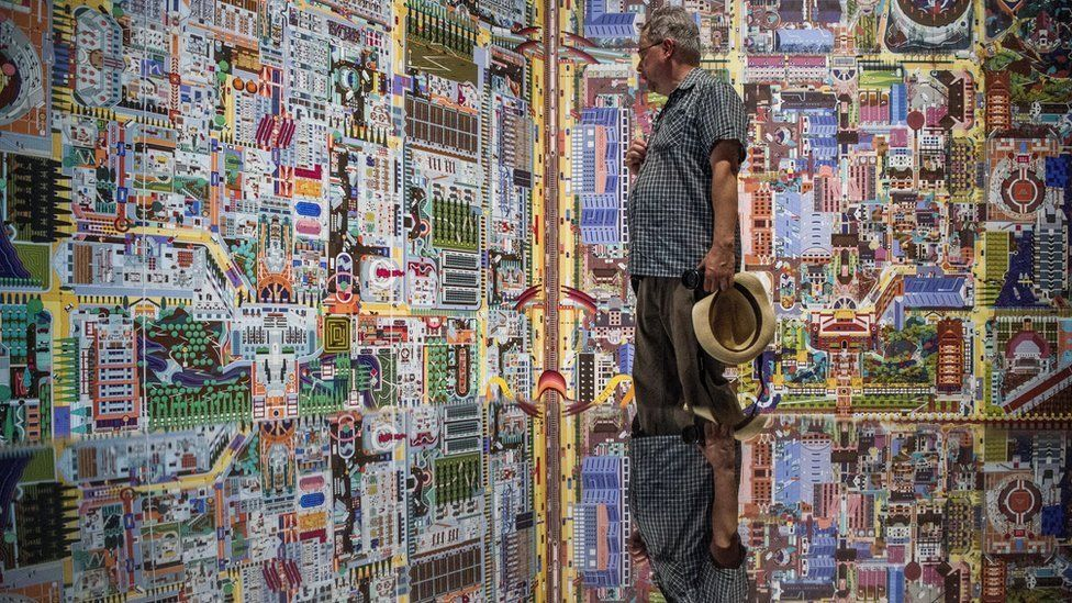 A visitor views the exhibition of China at the 16th Venice Biennale in Venice