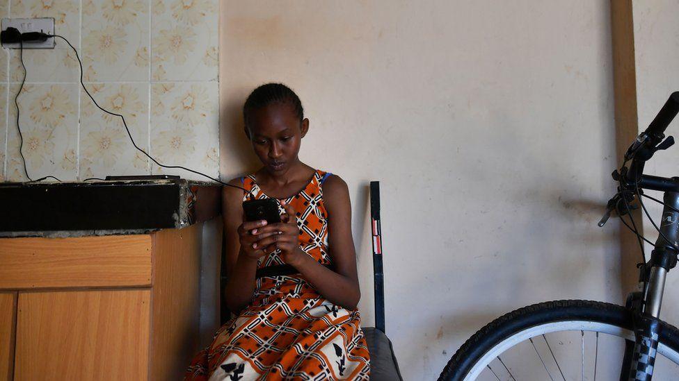 A Kenyan girl using a smartphone