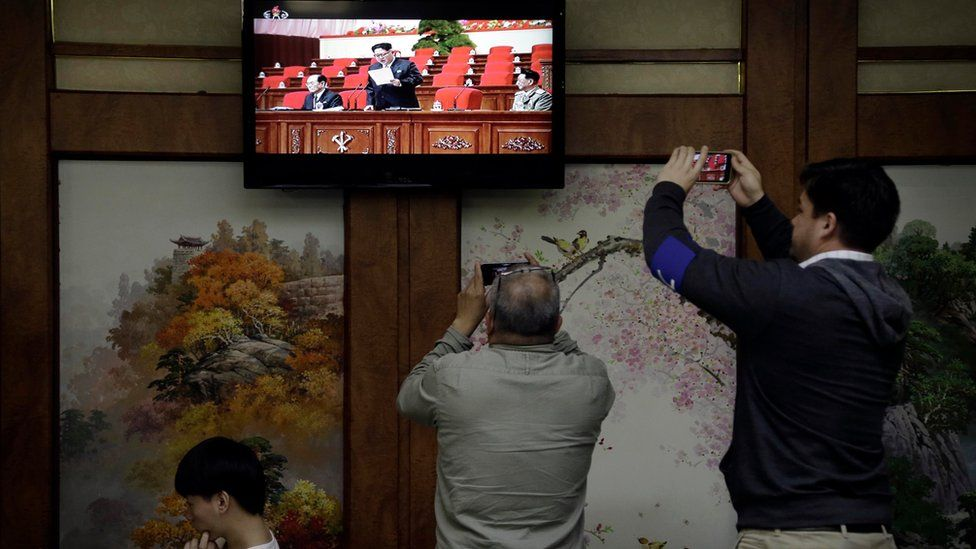 "Restaurant diners watch a broadcast of the 7th Congress of the Workers"" Party of Korea on local television, where North Korean leader Kim Jong Un is seen delivering a speech"