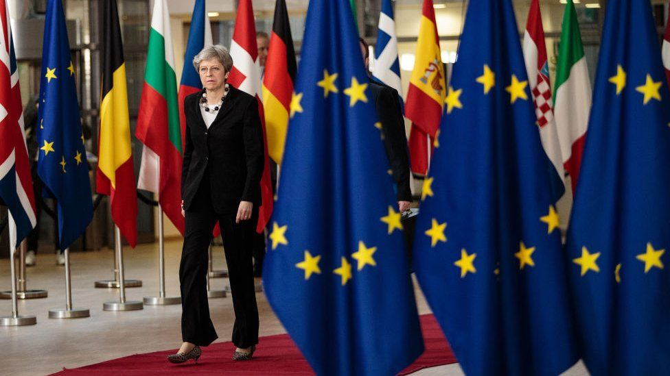 Theresa May arriving at a Council of the EU summit earlier in the year