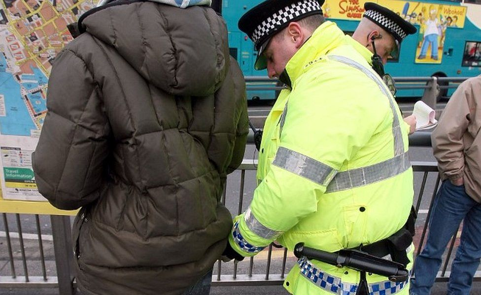 Officer carrying out stop and search