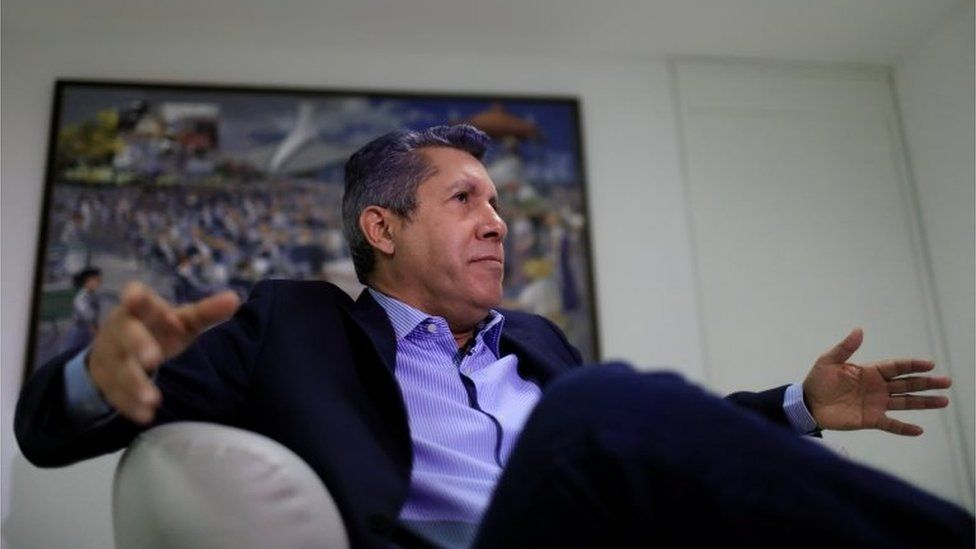 Venezuelan presidential candidate Henri Falcon gestures as he speaks during an interview with Reuters in Caracas, Venezuela February 28, 201